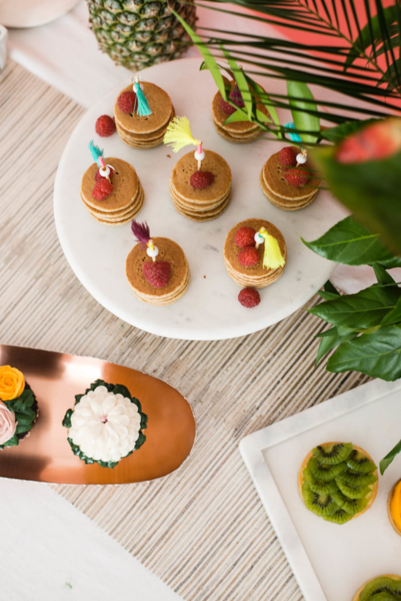 brunch buffet spread from above on copper and marble serving platters