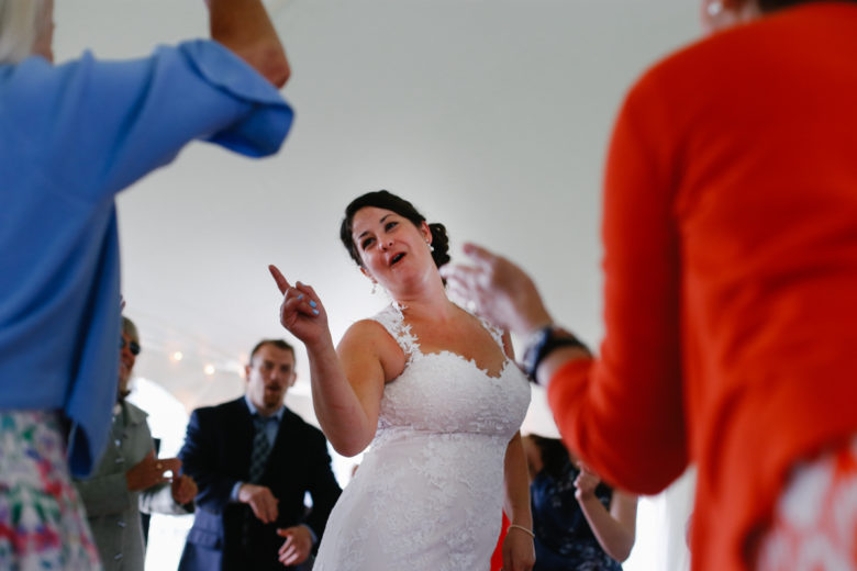 Bride in center of dance circle at reception