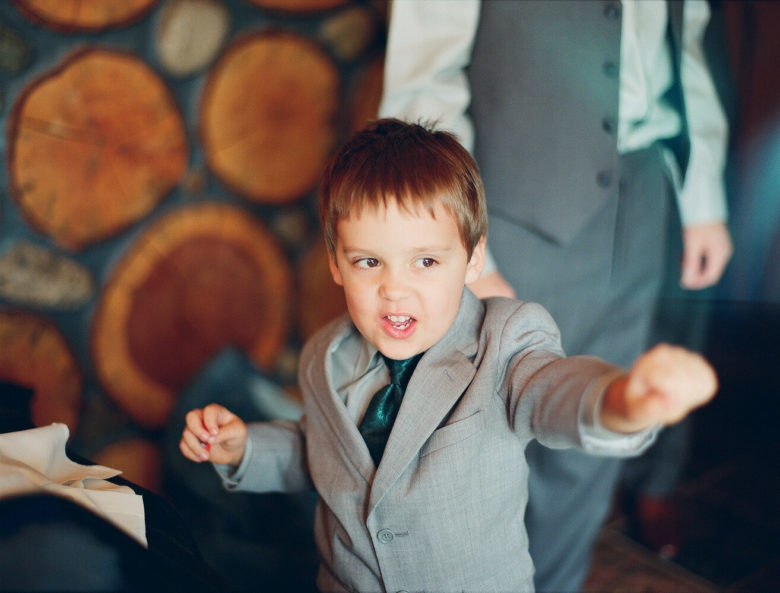 small boy in suit, tearing it up on the dance floor