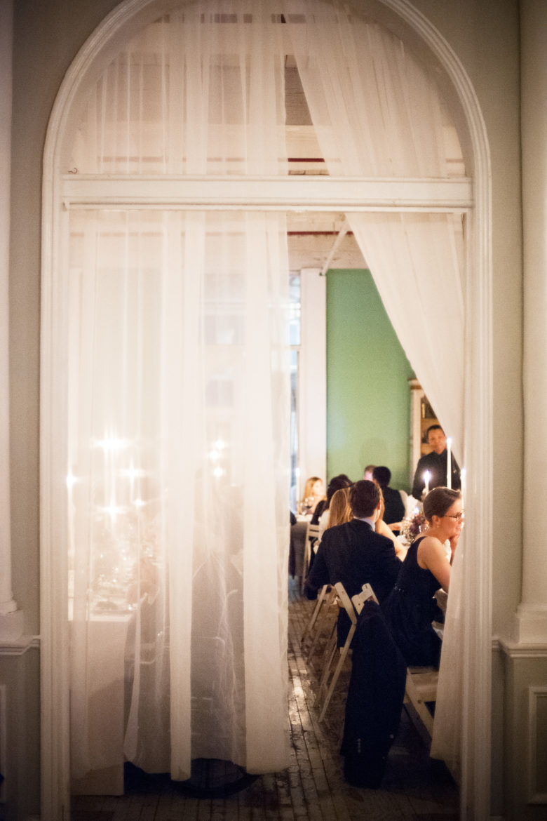 View through a large doorway into a wedding reception
