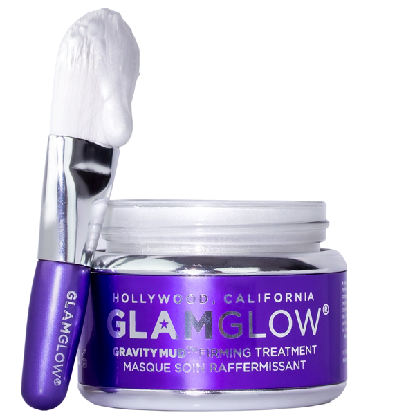 Purple jar of Glamglow skincare firming mask with applicator brush propped to the side