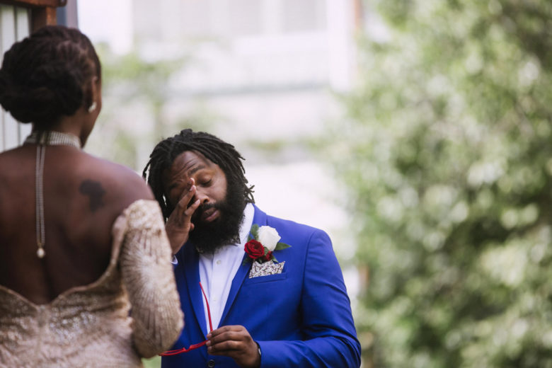 A man wipes away a tear during his wedding ceremony