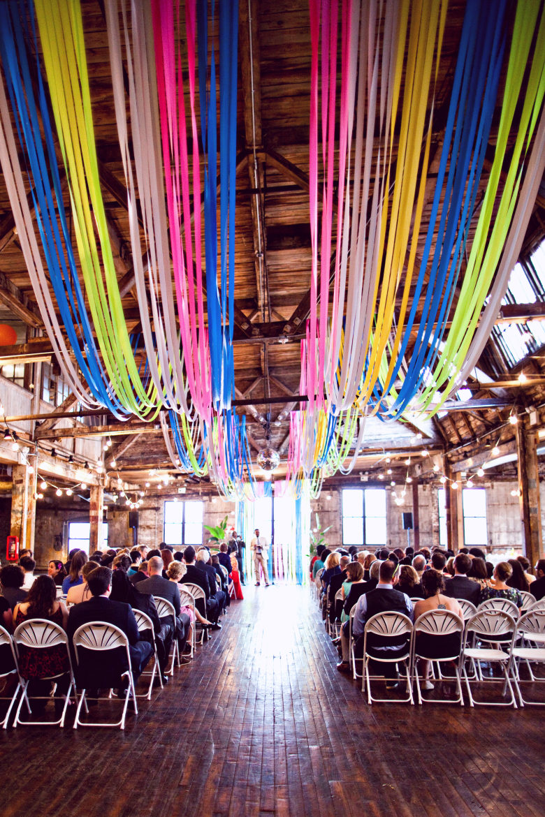 Wedding ceremony with flagging tape streamer ceiling for wedding decorations.