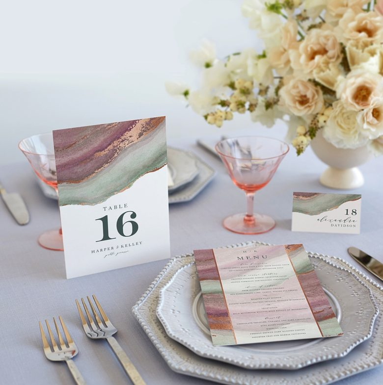 Wedding decorations featuring table setting with china, agate print table number, menu, and place card.