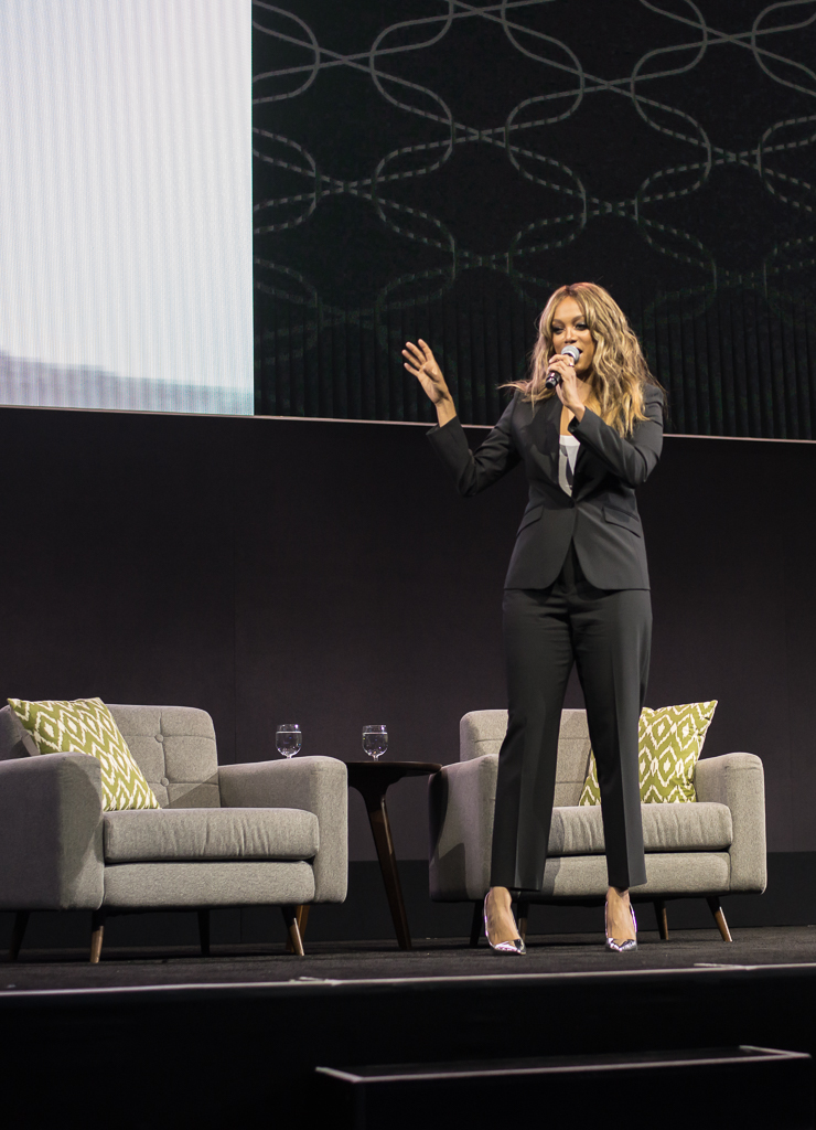 Tyra banks on stage in a suit
