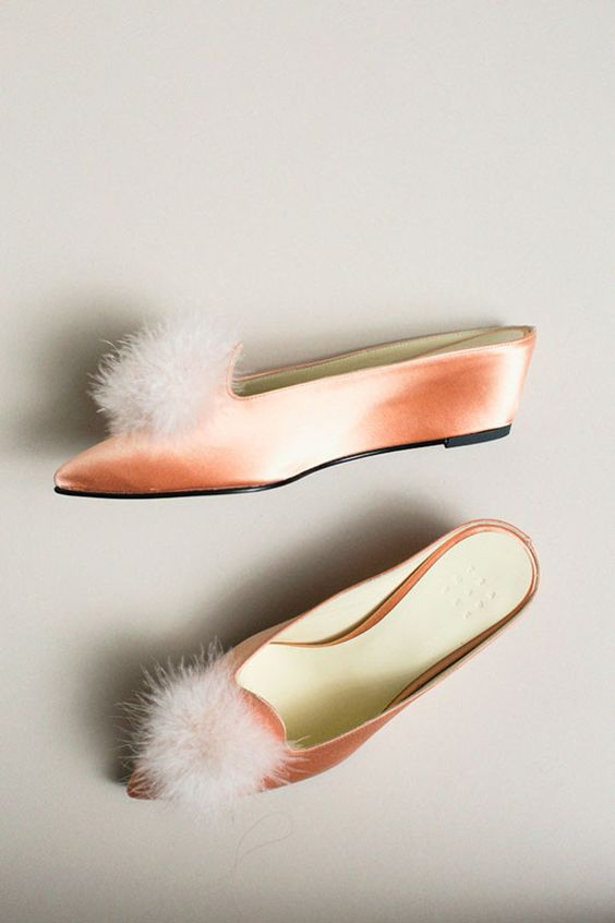 peach shoes with a furry tuft on the top
