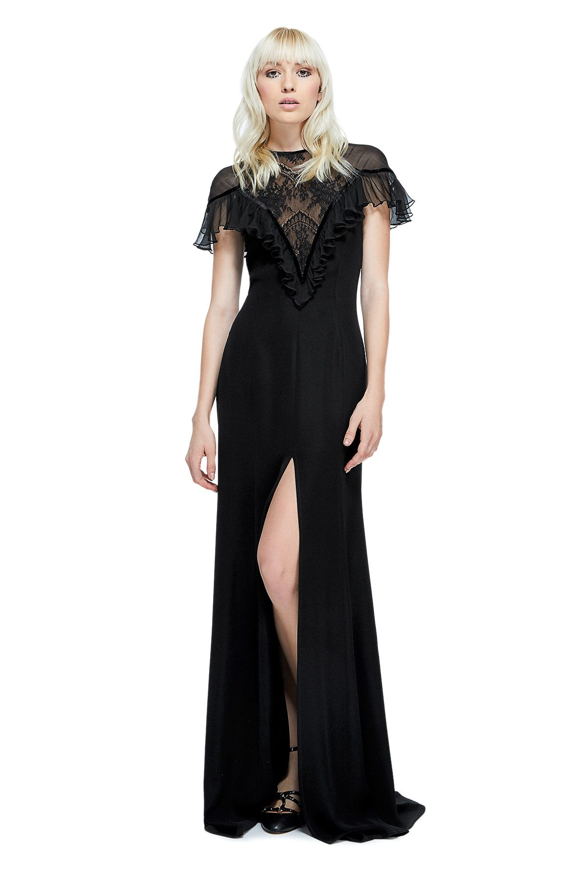 723ed4baa3d Platinum blonde model posing in black Victorian inspired sheath with lace  plunge neckline Tadashi Shoji gown