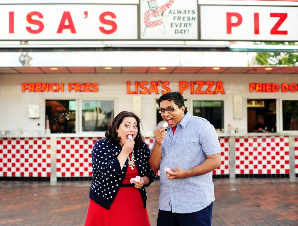engagement session photo of a couple eating fried dough