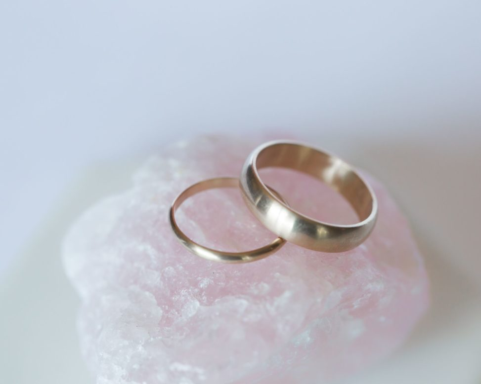 hand made wedding rings on a pink rock