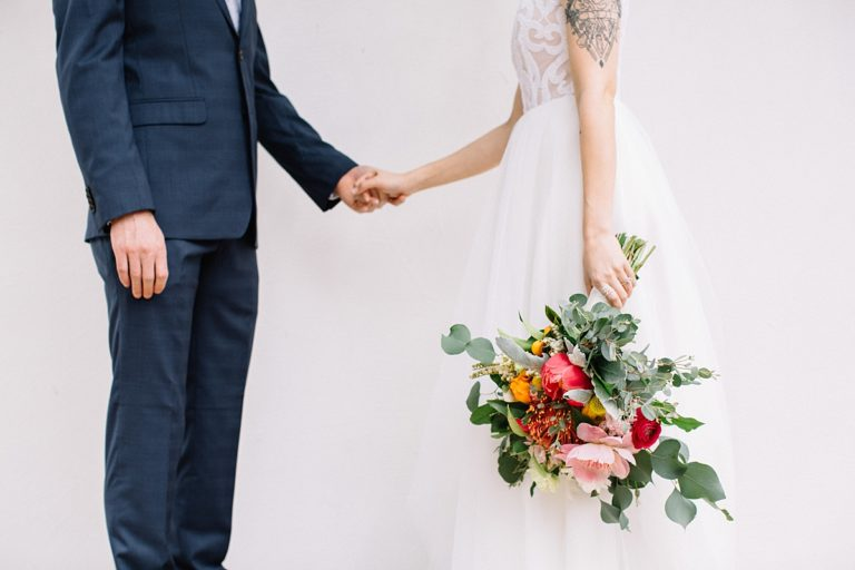 Bride and Groom holding hands, saying marriage vows