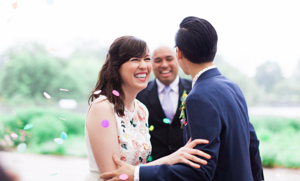 A couple laugh and smile during their wedding ceremony