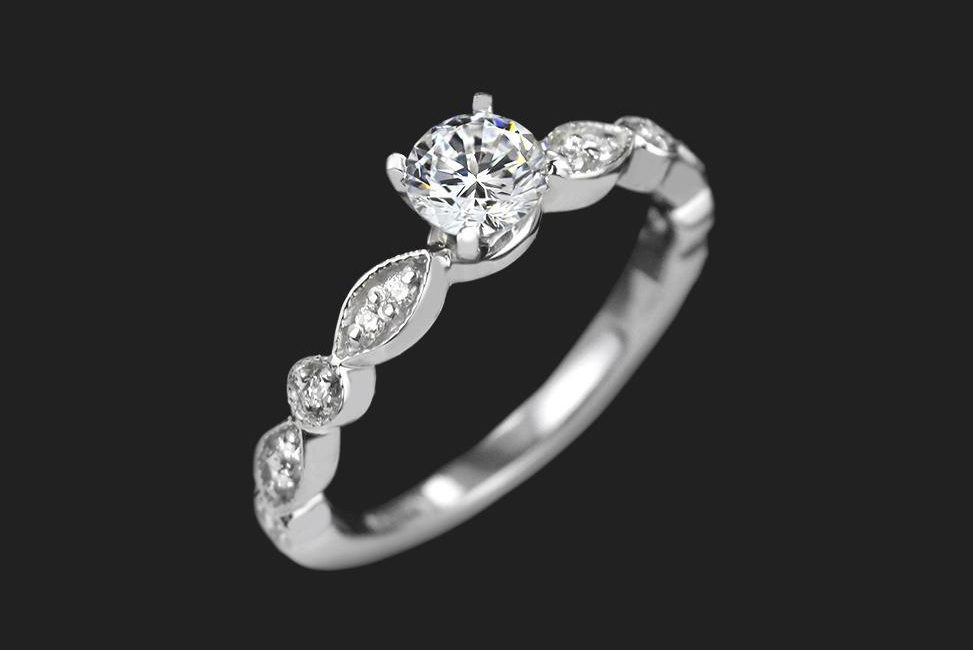 simple conflict free diamond engagement ring with unique band