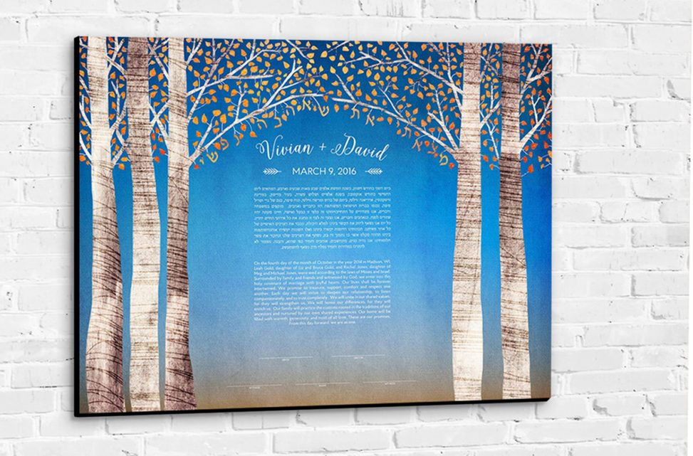 A colorful canvas ketubah with illustrated birch trees hanging on a wall