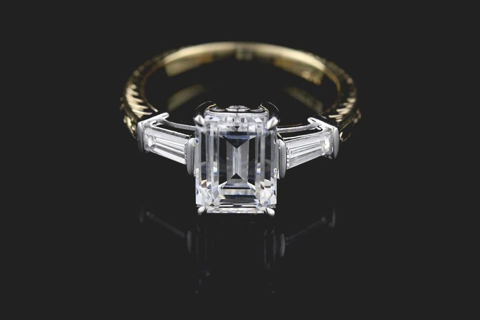 conflict-free emerald cut two tone diamond engagement ring