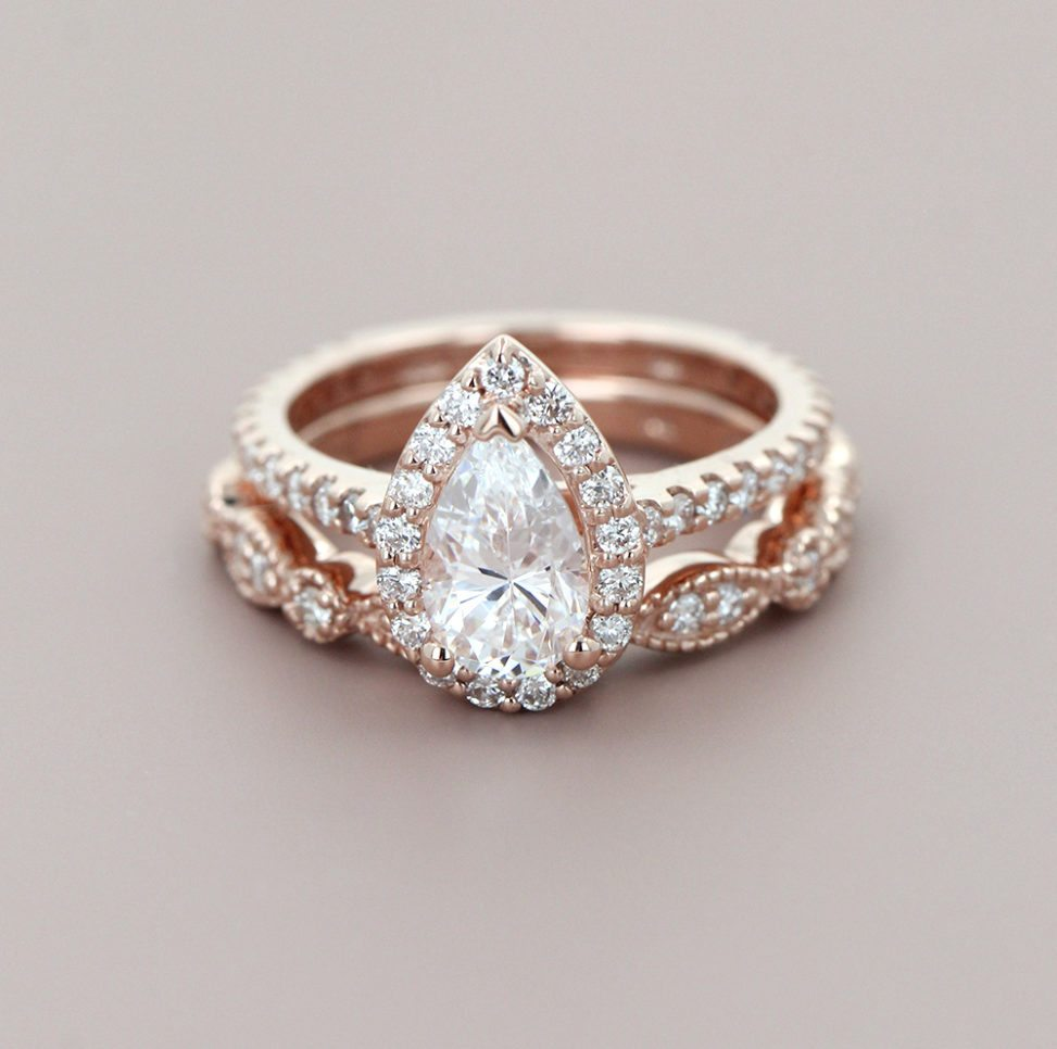 conflict-free pear shaped halo engagement ring and diamond wedding band from miadonna
