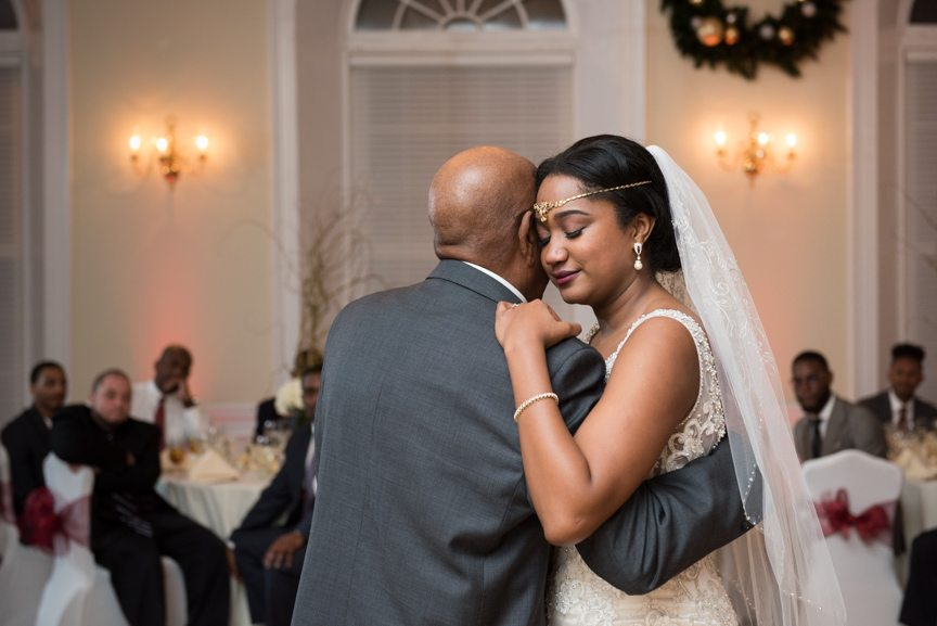 bride slow dancing with father