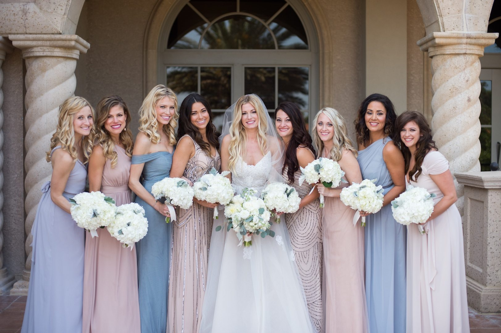 bridesmaids wearing mismatched bridesmaid dresses in cornflower blue and blush and sequins