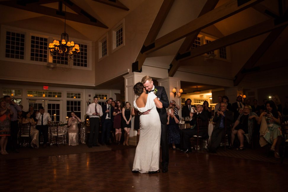 a bride and groom dance a slow dance during their reception