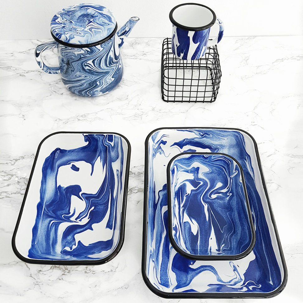 Marbled blue baking dishes on marble countertop