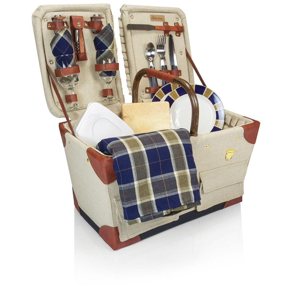 wedding gift ideas - a picnic basket on white filled with plaid towels and dishes