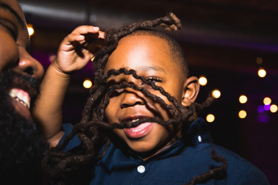 a child smiles during the wedding reception