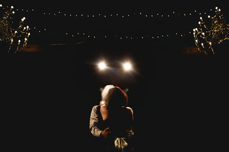 a wedding couple dance silently in the quiet darkness of their hearts