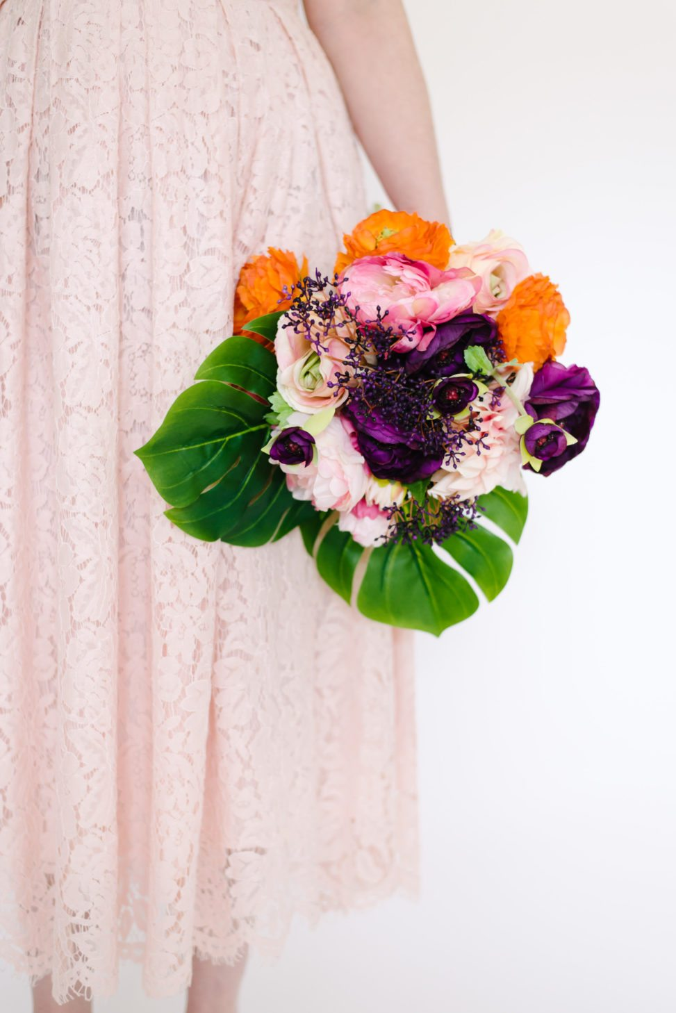 Fake floral bouquet that looks real with silk tropical leaves and silk multicolored flowers