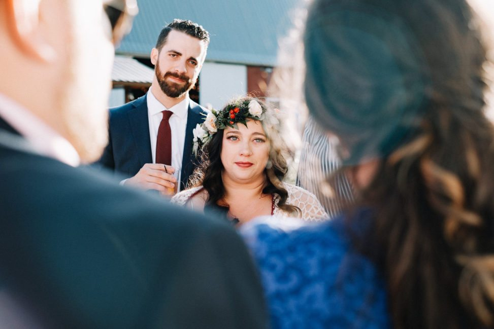 A bride looks at her parents during a speech