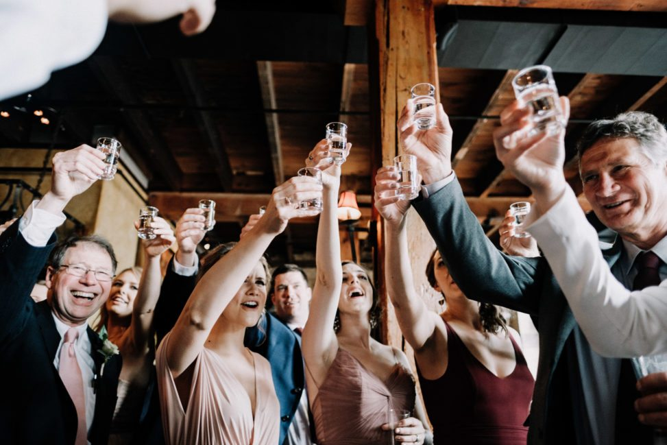 Everyone raising their glasses for a toast