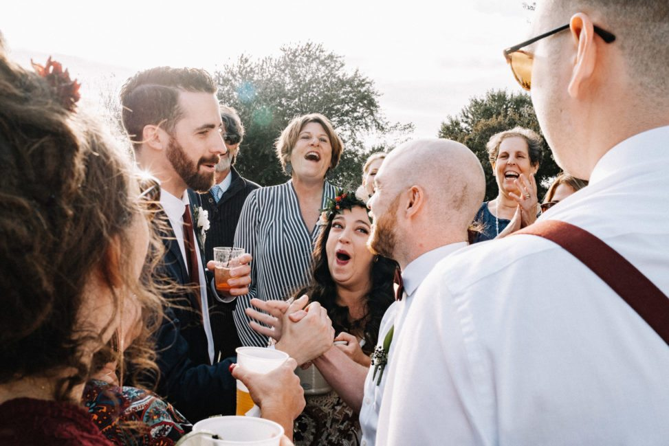 people making laughing O faces during a toast