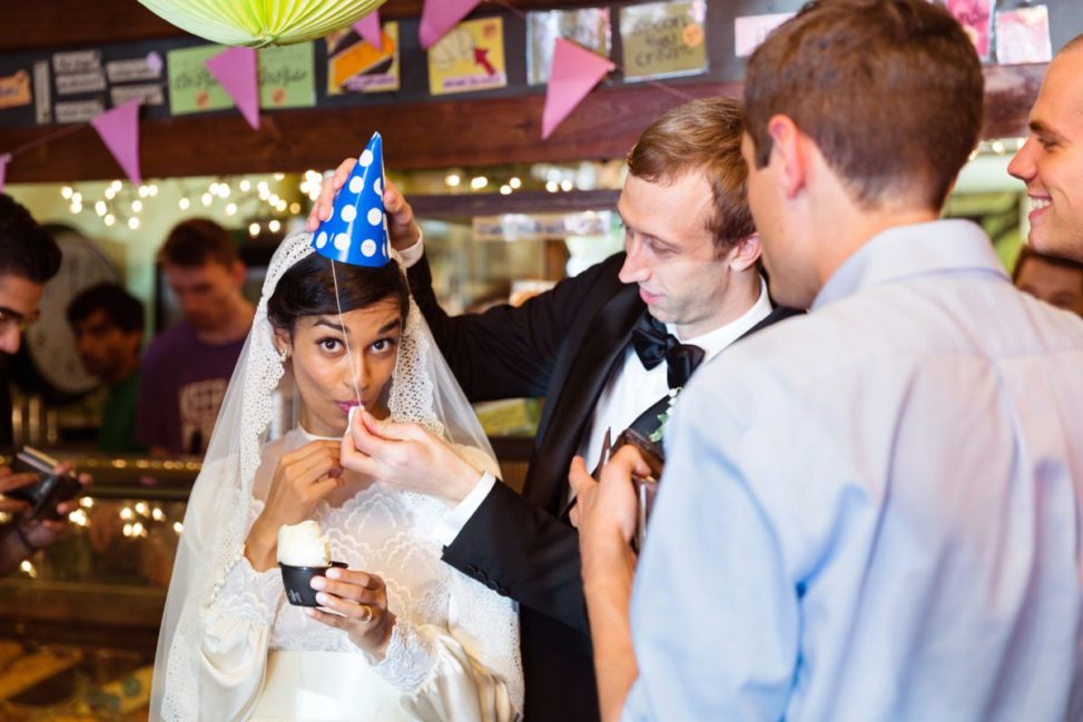 a man puts a party had on a bride