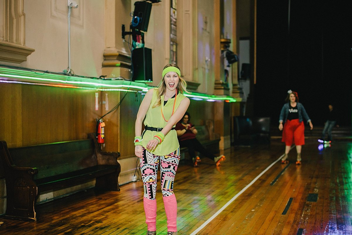 a woman roller skates with her mouth open