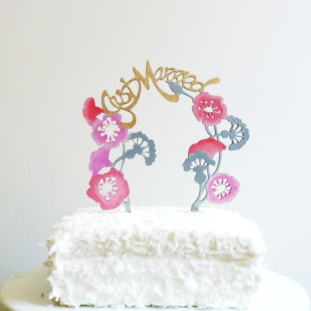 colorful wooden wedding arch cake topper that says just married