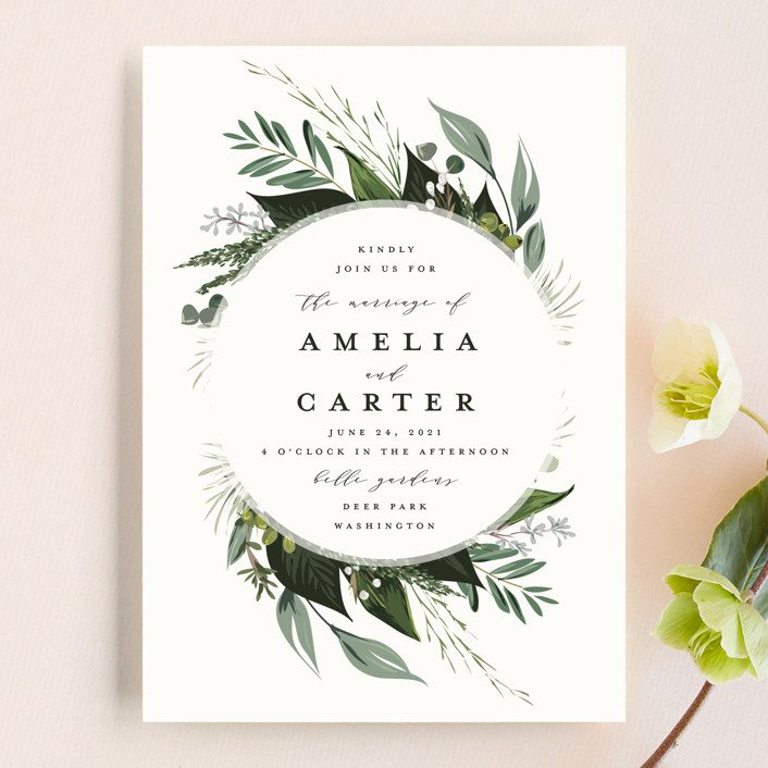Wedding invitation with florals and green leaf pattern