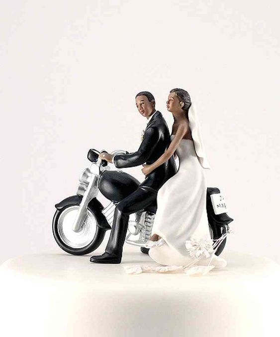 black bride and groom on a motorcycle wedding cake topper