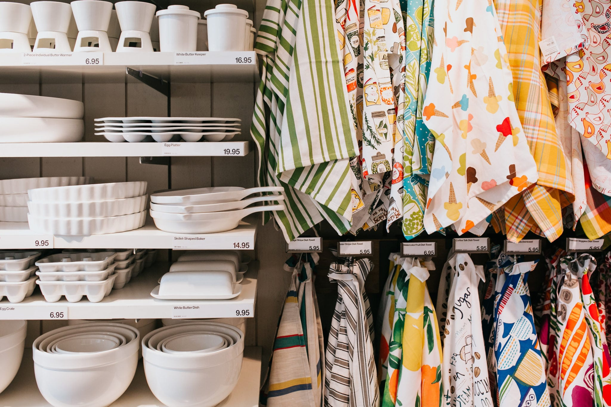 kitchen towels and white glassware at a crate and barrel private registry event